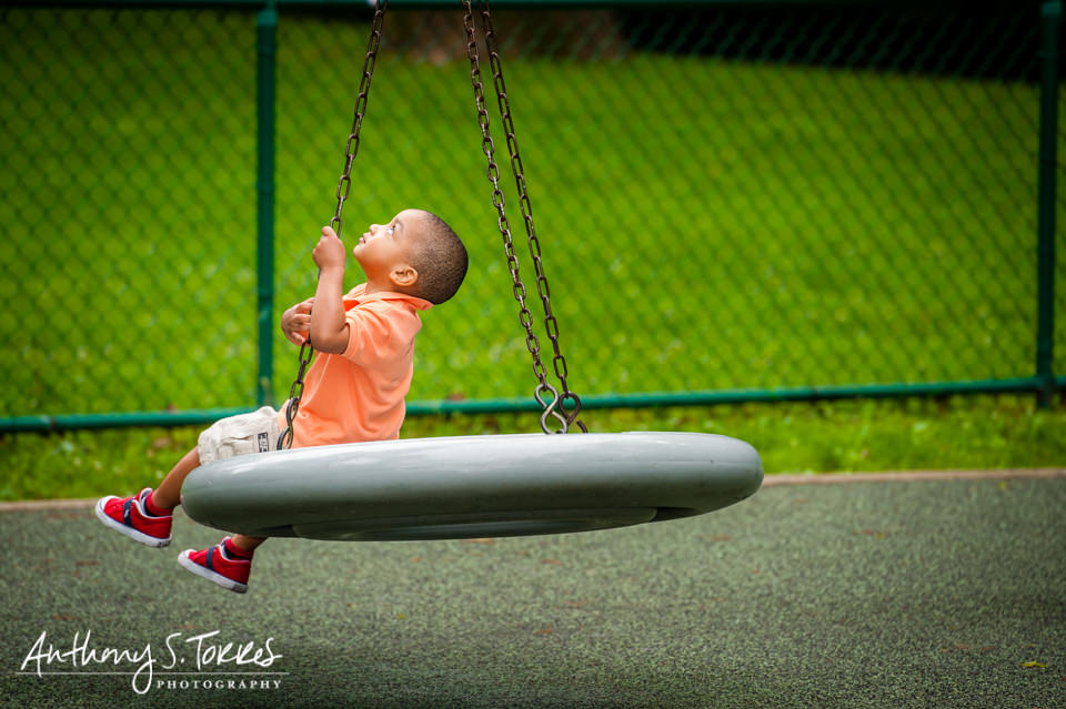 Child Photos - Grover Cleveland Park - Caldwell NJ - Boy Looking Up on Tire Swing